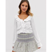 ASOS DESIGN top in crinkle with ruffle broiderie trim