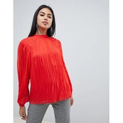 ASOS DESIGN pleated long sleeve blouse with tie back detail